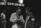 Bild (12/16): Ford GT 40 MkII (1966) - Dan Gurney (links) mit Team Chef Carroll Shelby - kurze Besprechung während den Nachtstunden des Rennens (12 Stunden von Sebring 1966) (© Fotograf: Dave Friedman, 1966)
