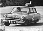 Ford Lotus Cortina (1964) - Sir John Withemore (GB) bei der (Lenk-) Arbeit (© Archiv Automobil Revue)